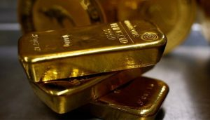 Read more about the article Gold ticks up on softer currency